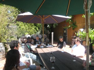 """Emil Tedeschi at the table with guests at Tedeschi Family Winery in Napa"""