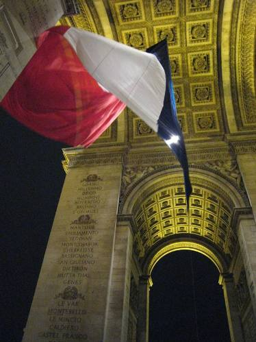 """French flag flying at the Arc de Triomphe in Paris"""