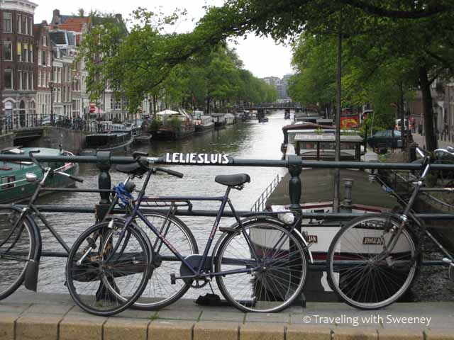 """In Amsterdam Bikes and Boats are seen everywhere"""