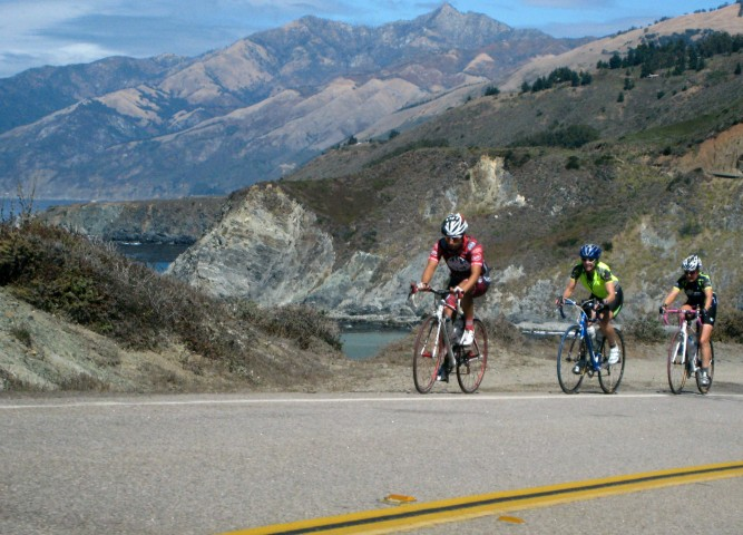 """""""Bicyclists riding along Big Sur on the Pacific Coast Highway in California"""""""