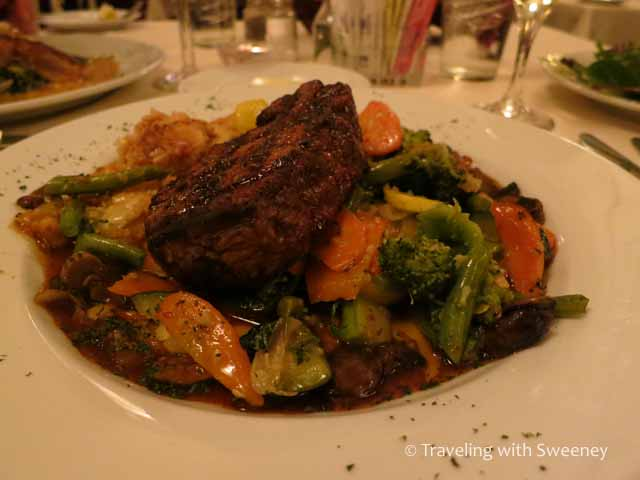 Steak with au gratin potatoes and sauteed vegetables