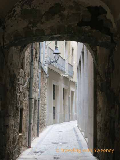 Narrow cobblestone street in Girona