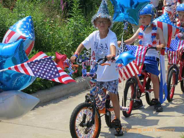 """Kids Riding Bikes in Patriotic Gear for 4th of July Parade in Marinette, Wisconsin"""