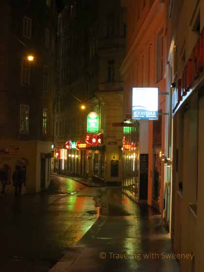 """A quiet, narrow street at night in romantic Vienna"""