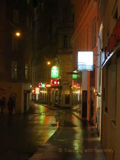 """A quiet, narrow street at night in romantic Vienna"""