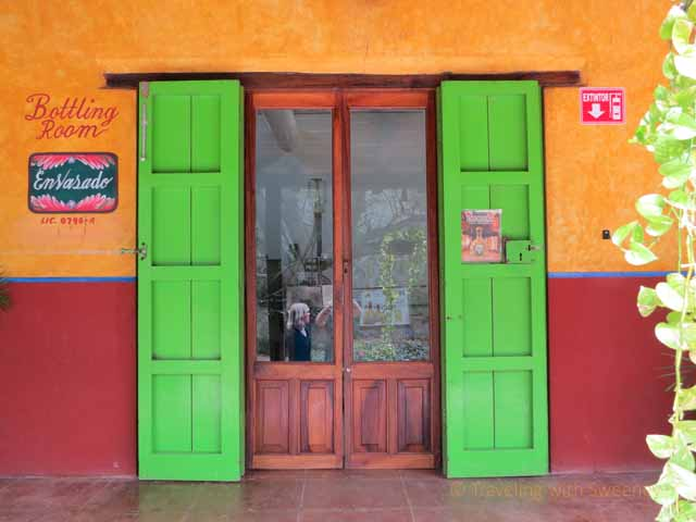 """Colorful doorway of bottling room at Los Osuna tequila factory in Sinaloa, Mexico"""