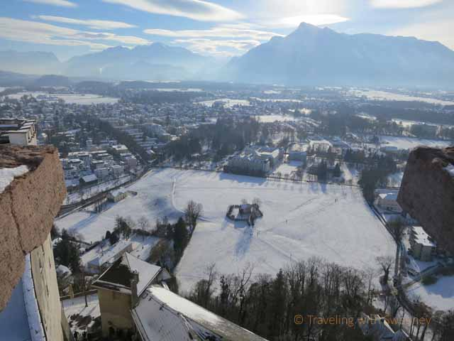"""""""View from Hohensalzburg Fortress of the Alps and a lone home in a meadow"""""""