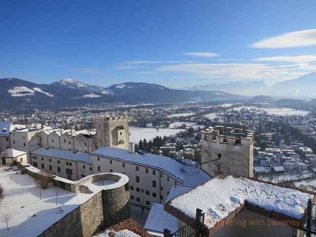 """View of the fortress rooftops and Austrian countryside from the recturm at the top of Hohensalzburg Fortress"""