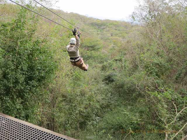 """Zip-lining on a one mile, nine platform course at Huana Coa Adventure Park near Mazatlan, Mexico"""