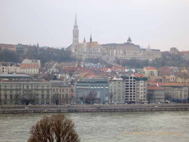 """The tower of St Matthias Church in the Buda hills across the Danube from the Four Seasons hotel"""