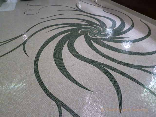 """Even the mosaic tile floor in the lobby of the Four Seasons Gresham Palace exudes artistic Art Nouveau elegance"""