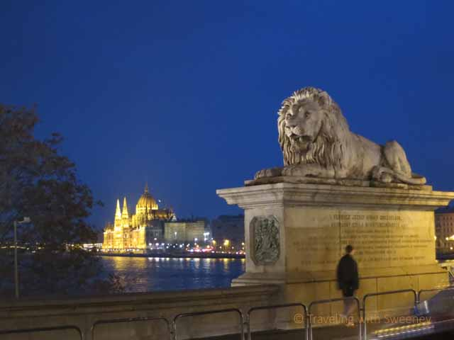 """Budapest photos: Hungarian Parliament from the Chain Bridge (Széchenyi lánchíd) with lion statue"""