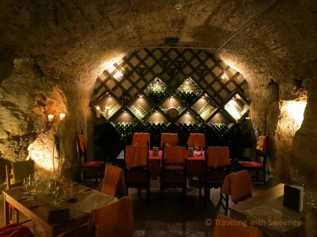"""Tables in the cave of Faust Wine Cellar beneath Budapest Hilton Hotel"""