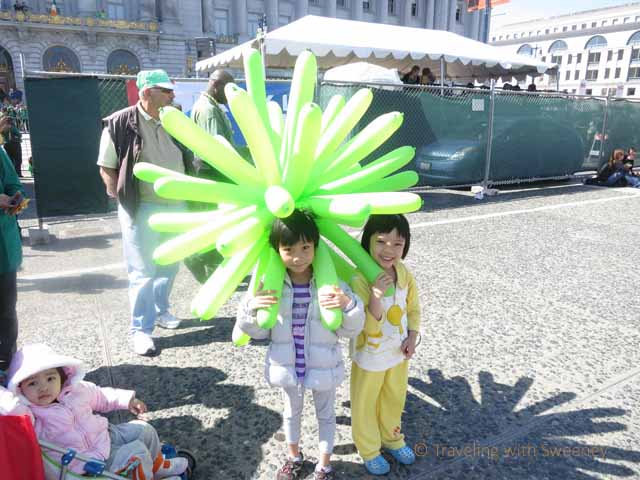 """Children and green balloons at St. Patrick's Day parade in San Francisco"""