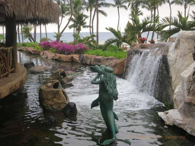 """Mermaid in water next to Humuhumunukunukuapua'a Restaurant at Grand Wailea restaurant, Maui"""