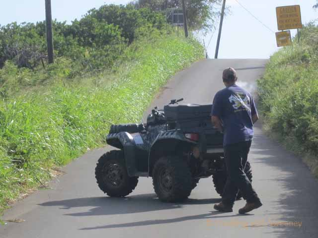 """Maui rancher and ATV blocking the road on Haleakala backside road from Hana"""