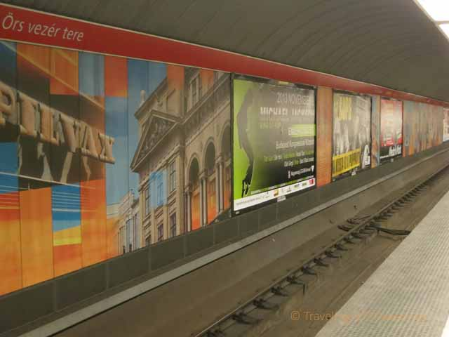 """Colorful murals in Budapest Metro station"""