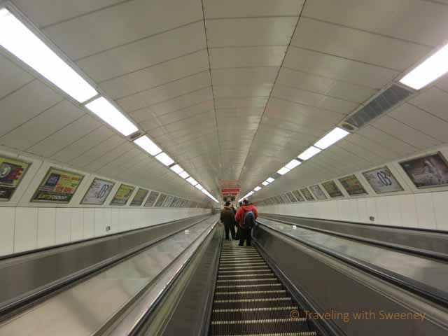 """Long, fast and steep escalator in Metro station in Budapest"""