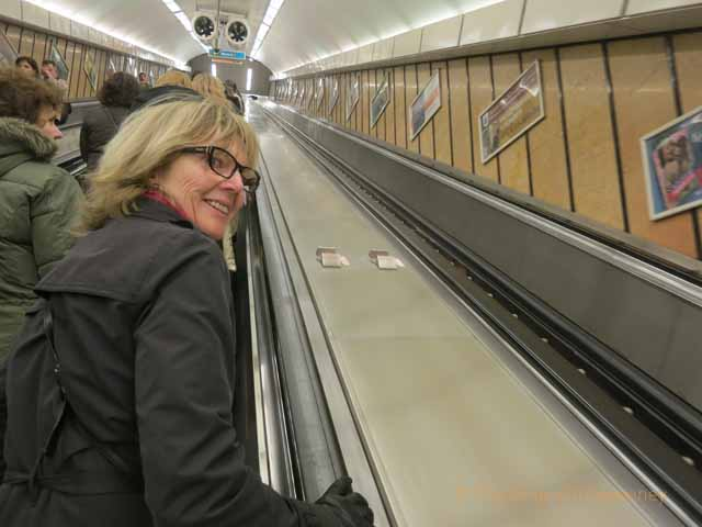 """Riding the escalator at Metro station in Budapest"""
