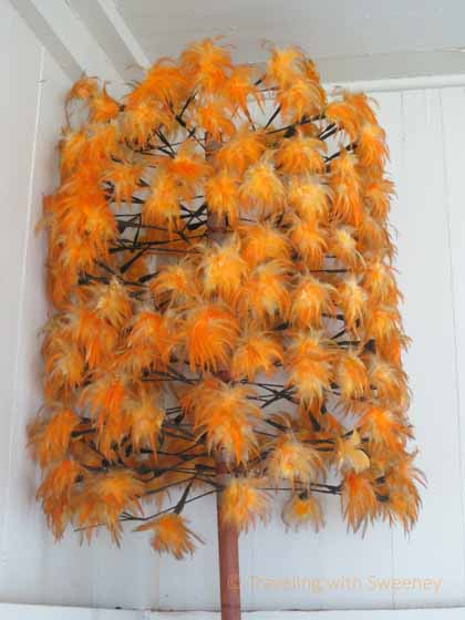 """Hawaiian culture artifact at Hana Cultural Center - Orange feather staff used to warn people that the king was about to arrive"""