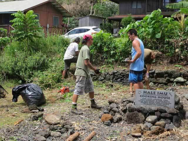 """Student volunteers building a hale as part of the Maui hale competition in April 2013, Maui"""