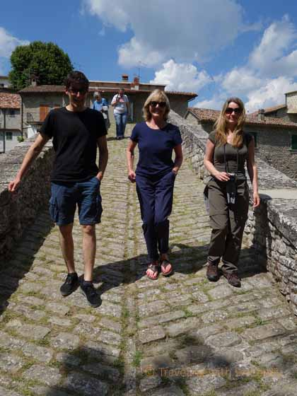 """Walking across the Maestà (Majesty) Bridge on a tour of the village of Portico di Romagna, Italy"""