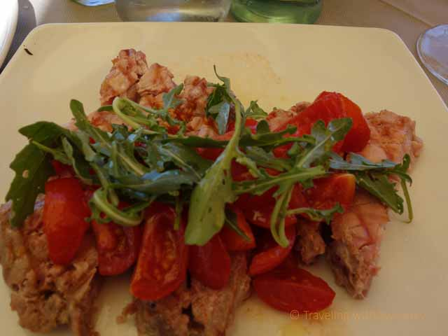 """Raw fish with tomatoes and arugula at Balnearea Beach, Otranto"""