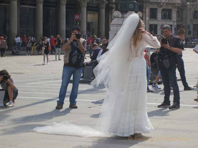 """""""Model wearing a wedding gown in a fashion shoot in Piazza del Duomo, Milan, Italy"""""""