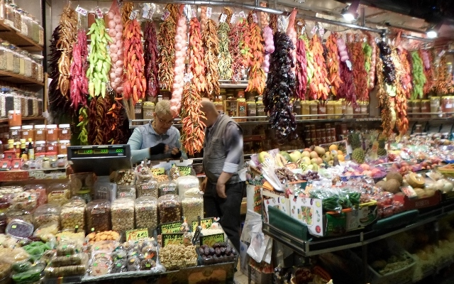 """Colorful wares on display at La Boqueria in Barcelona"""