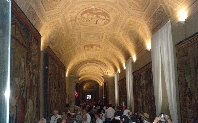 """Frescoes in the entrance to the Sistine Chapel in Rome"""