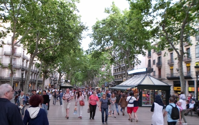"""Walking down the tree-lined Ramblas, Barcelona"""