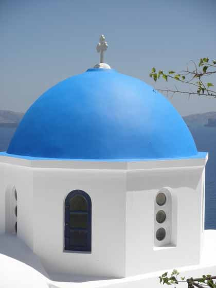 """Blue domed church steeple in Santorini"""