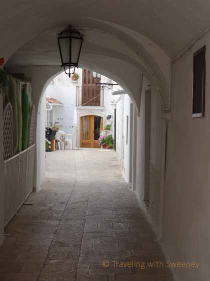 """Passageway leading to courtyard in Locorotondo, Italy"""