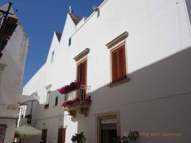 """Lovely buildings and flowers seen along a walk in Locorotondo"""