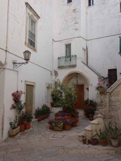 """Courtyard with flowers in Locorotondo, Italy"""