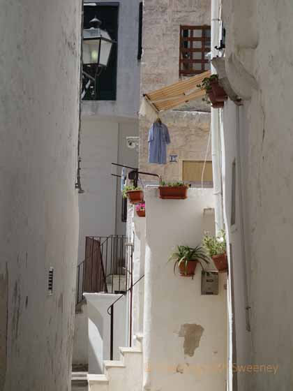 """Laundry hanging on a balcony in Centro Storico Cisternino"""