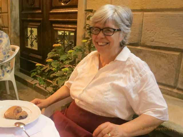 """Marisa Cameli at the table in front of Al Vecchio Convento having dessert"""