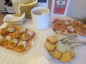 """Complimentary breakfast in lobby at Hofsas House Hotel in Carmel, California"""