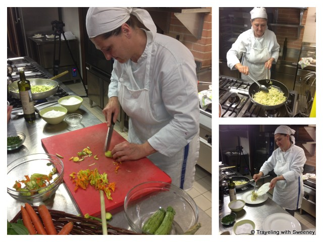 """Chef preparing dinner in the kitchen at Collina dei Poeti in Santarcangelo, Italy"""