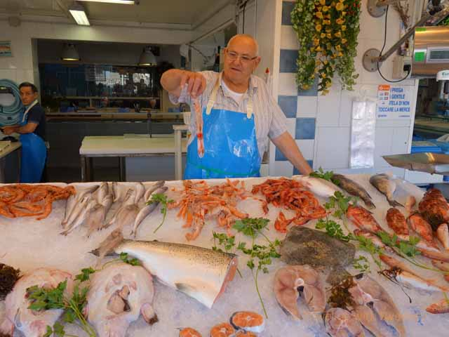 """Fish vendor at Pescheria del Nonno in Triggiano near Bari, Italy"""