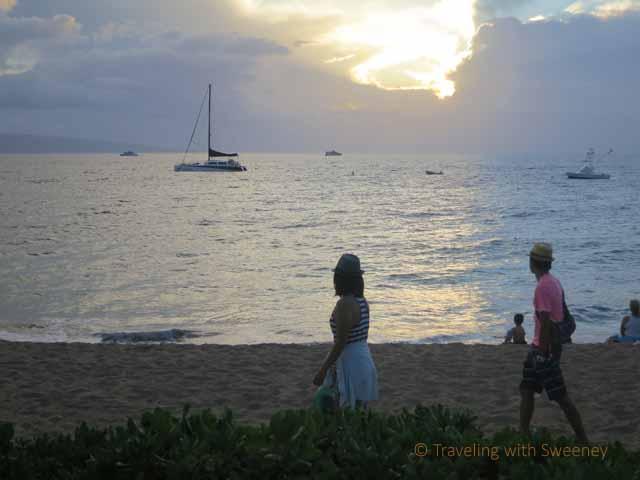 """""""People walking along Ka'anapali Beach at sunset"""""""