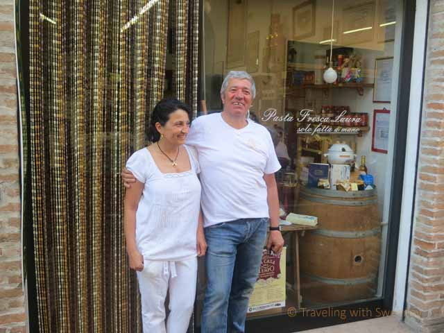 """Owners Laura and Michele outside of Pasta Fresca Laura in Santarcangelo, Italy"""