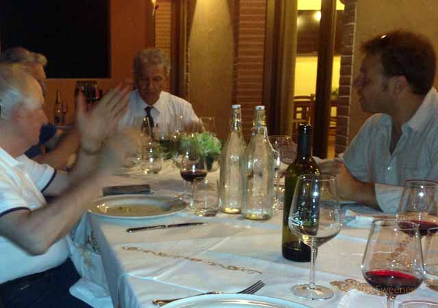 """Pino, Sauro, Sergio and Sebastiano at the table at Collina dei Poeti in Santarcanglo, Italy"""