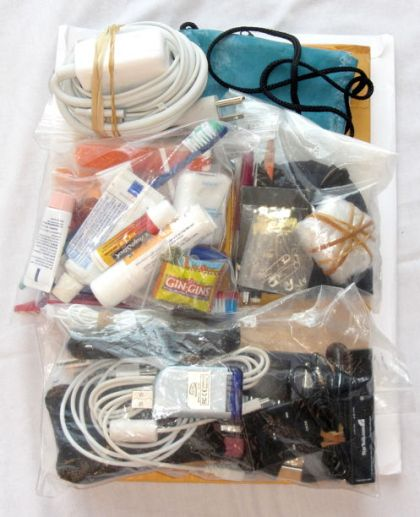 """""""Condensed view of personal and electronics items to pack for a trip"""""""