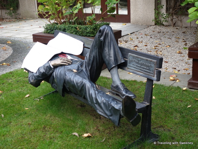 """Sculpture by J. Seward Johnson of a man on a bench in the courtyard of the Four Seasons Hotel Dublin"""