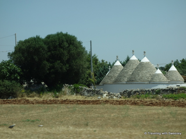 """Trulli seen along the road in the Valle d""Itria, Puglia, Italy"""