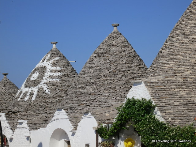 """Sun symbol on trullo roof in Alberobello, Italy"""