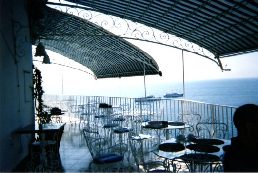 """Hotel terrace overlooking the Mediterranean on the Amalfi Coast"""