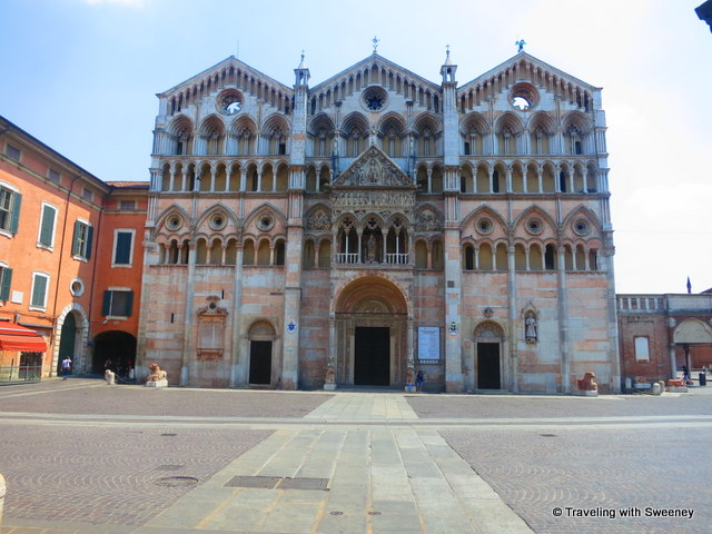 """Pink and white marble facade of Ferrara Cathedral"""