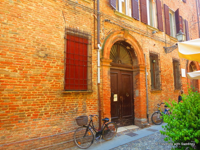 """Building along a narrow street in old Jewish ghetto of Ferrara, Italy"""